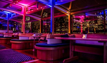 Private Corporate Party aboard yacht Manhattan II at night with NYC as the background