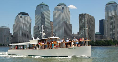 Yacht Manhattan in the Hudson River with the Financial District in the background