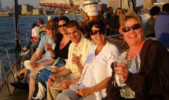 Friends out on a sailboat in NY Harbor for a wine pairing.