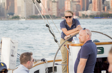 Captain and crew sailing the yacht Schooner America 2.0 in NY Harbor